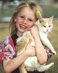 Girl playing with senior cat