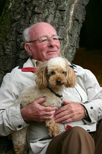 Old Man Holding Dog